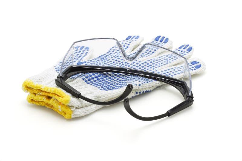 De beschermende brillen van de veiligheid en katoenen handschoenen royalty-vrije stock afbeelding