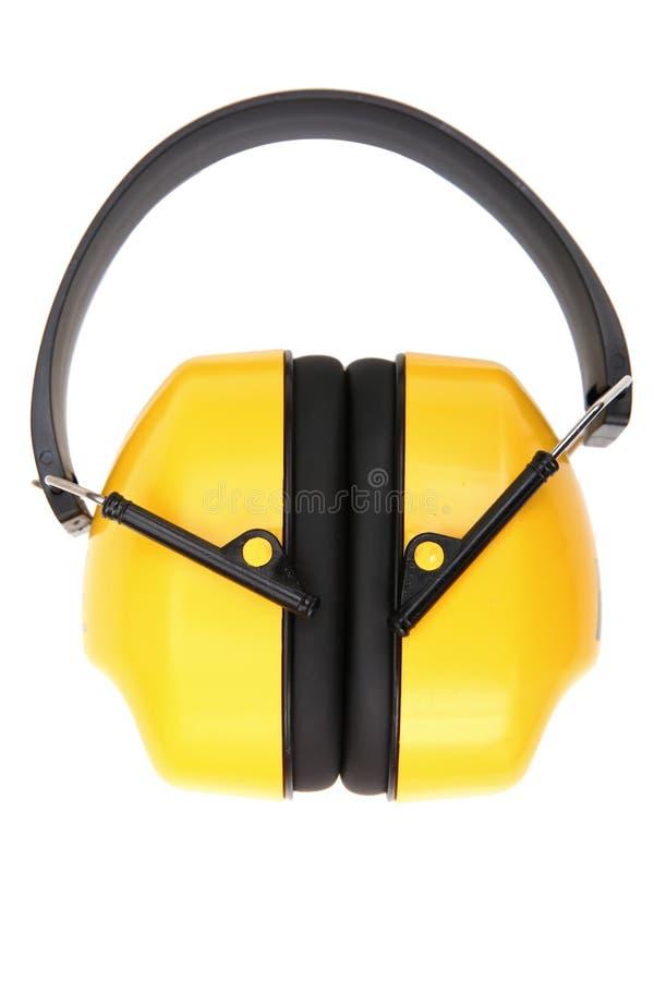 De beschermende hoofdtelefoons worden gebruikt om lawaai te verminderen dat in de werkplaats kan zijn royalty-vrije stock afbeelding