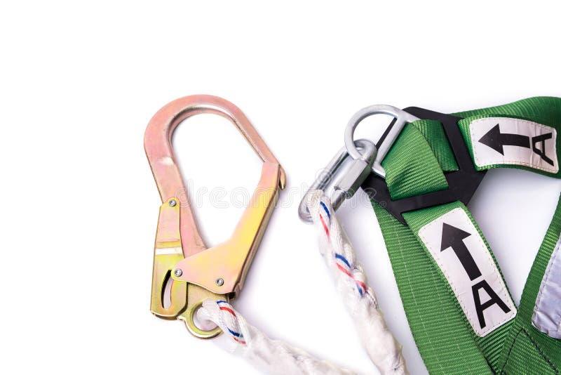 De beschermingsuitrusting en sleutelkoord van de close-updaling voor het werk bij hoogten stock foto