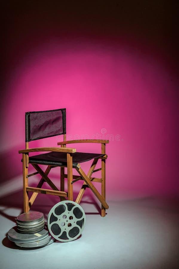 De stoel van de regisseur met filmspoel stock fotografie