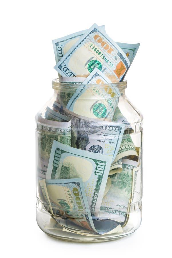 de besparingen van de conceptenfoto - een glaskruik met 100 dollar rekeningen wordt gevuld die royalty-vrije stock foto