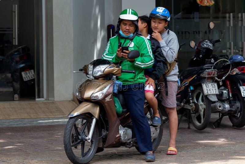 De bestuurder Ho Chi Minh City van de greepmotor royalty-vrije stock afbeelding