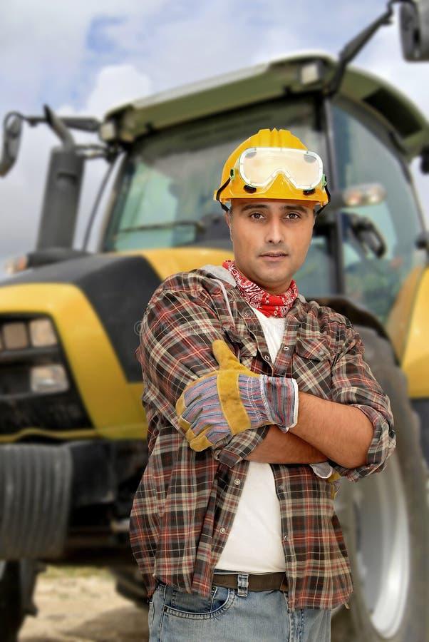 De bestuurder van de tractor stock foto