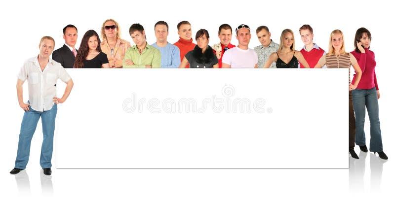De bevindende mensen groeperen zich met raad voor tekst stock afbeeldingen