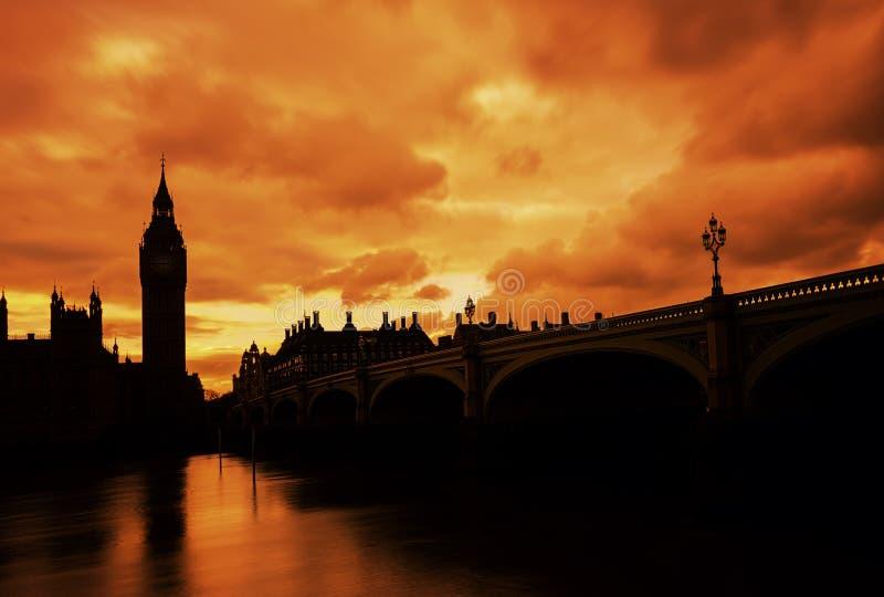 De Big Ben, lange blootstelling, zonsondergang, Londen het UK stock afbeeldingen
