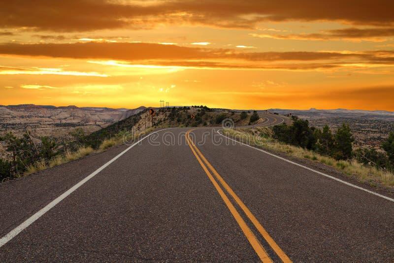 De Binnenweg en de Woestijnlandschappen van het varken bij Zonsondergang, Escalante Nationaal Monument, Utah royalty-vrije stock afbeelding