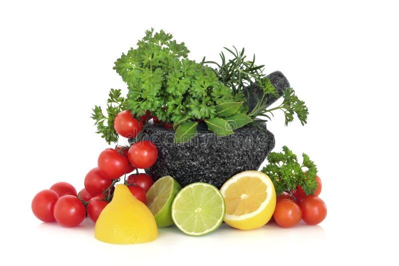 De Bladeren, het Fruit en de Tomaten van kruiden stock foto's