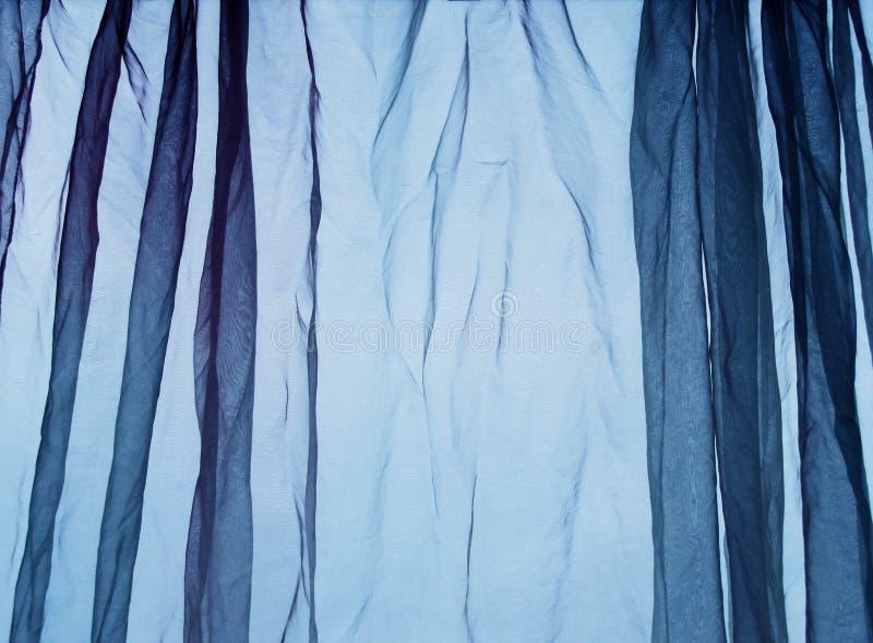 De blauwe achtergrond van het voilegordijn stock afbeeldingen