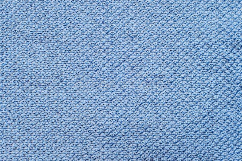 De blauwe breiende achtergrond van de stoffentextuur stock fotografie
