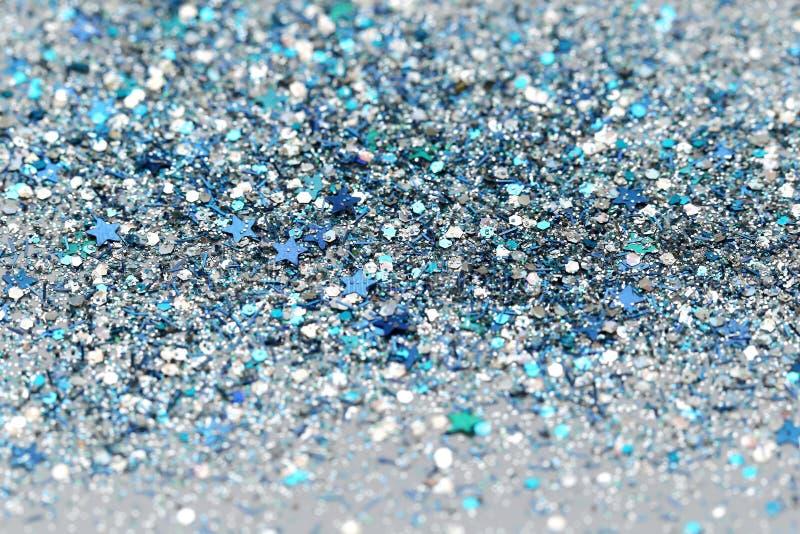 De blauwe en Zilveren Bevroren Fonkelende Sterren van de Sneeuwwinter schitteren achtergrond Vakantie, Kerstmis, Nieuwjaar abstra stock afbeeldingen