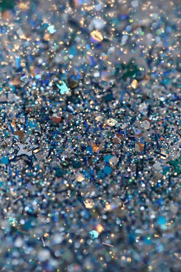 De blauwe en Zilveren Bevroren Fonkelende Sterren van de Sneeuwwinter schitteren achtergrond Vakantie, Kerstmis, Nieuwjaar abstra stock fotografie