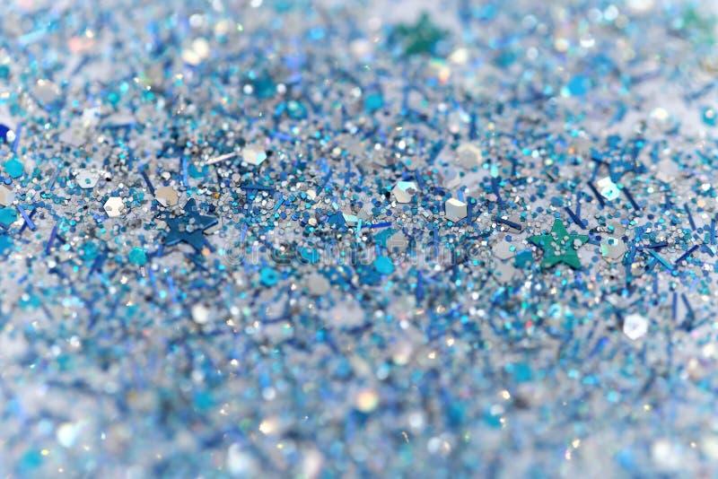 De blauwe en Zilveren Bevroren Fonkelende Sterren van de Sneeuwwinter schitteren achtergrond Vakantie, Kerstmis, Nieuwjaar abstra royalty-vrije stock afbeeldingen