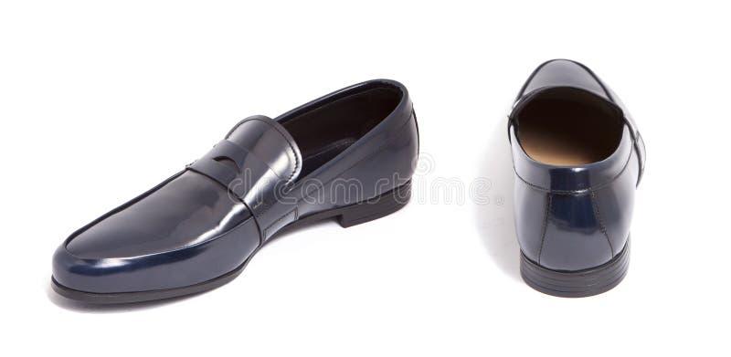 De blauwe glanzende schoen van leermensen stock fotografie