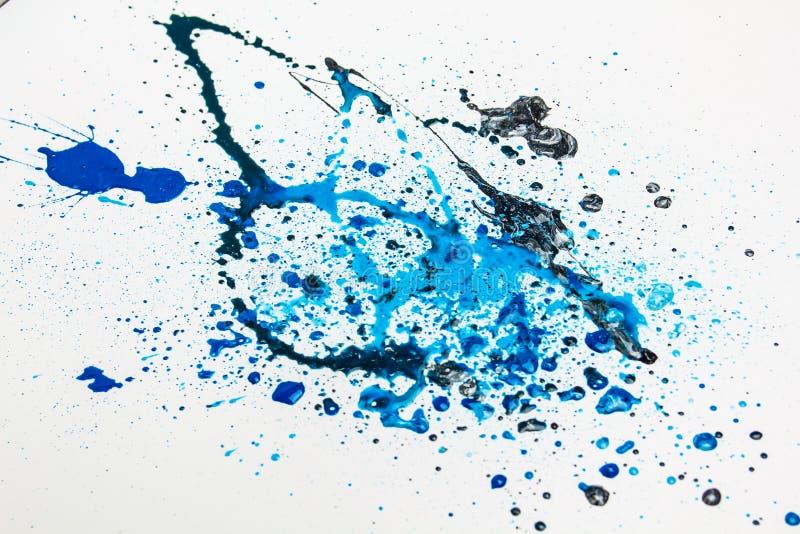 De blauwe Plonsen van de Verf   royalty-vrije stock afbeelding