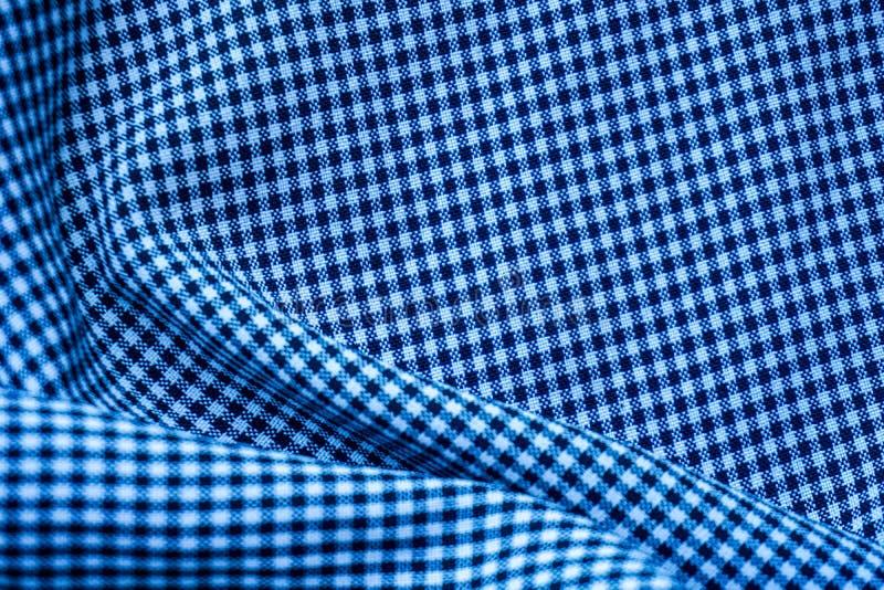 De blauwe stof van het golfpatroon voor achtergrond of oppervlakte stock foto