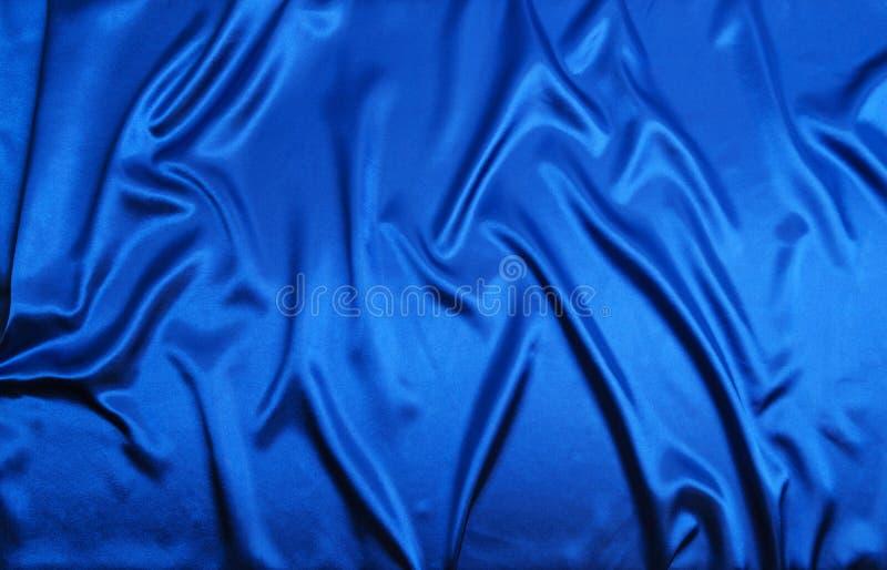 De de blauwe textuur of achtergrond van de zijdedoek royalty-vrije stock afbeelding