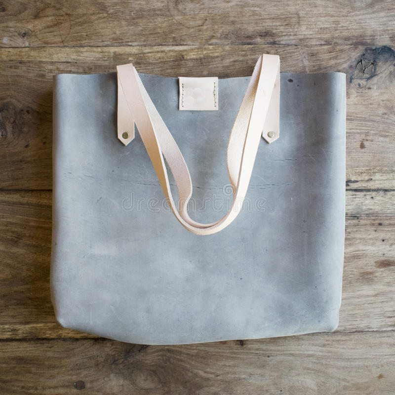 De blauwe zak van de suèdeontwerper stock fotografie