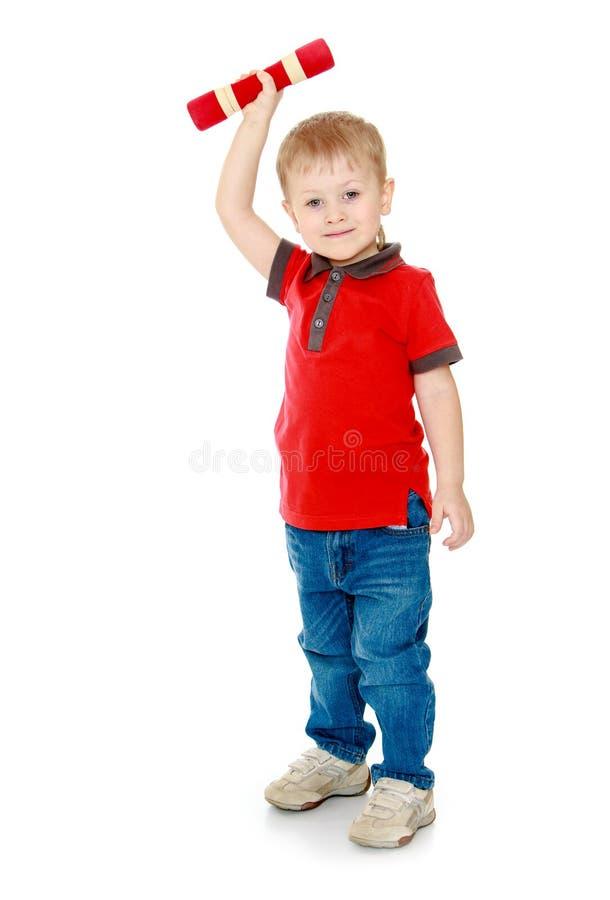 De blonde jongen die een domoor houden royalty-vrije stock foto