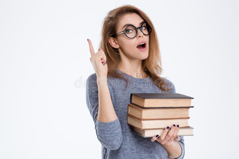 De boeken van de vrouwenholding en het benadrukken van vinger stock foto's