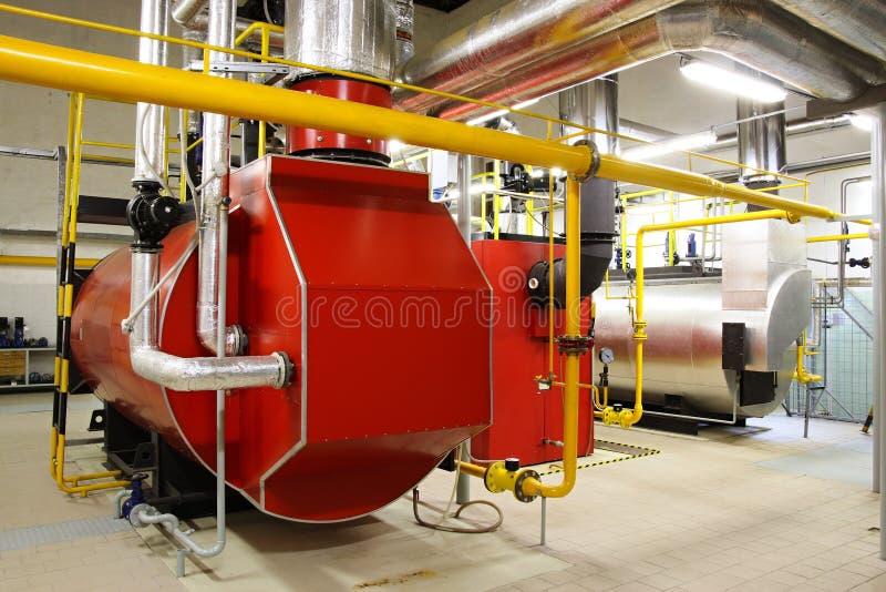 De boilers van het gas in gasketelruim stock afbeeldingen