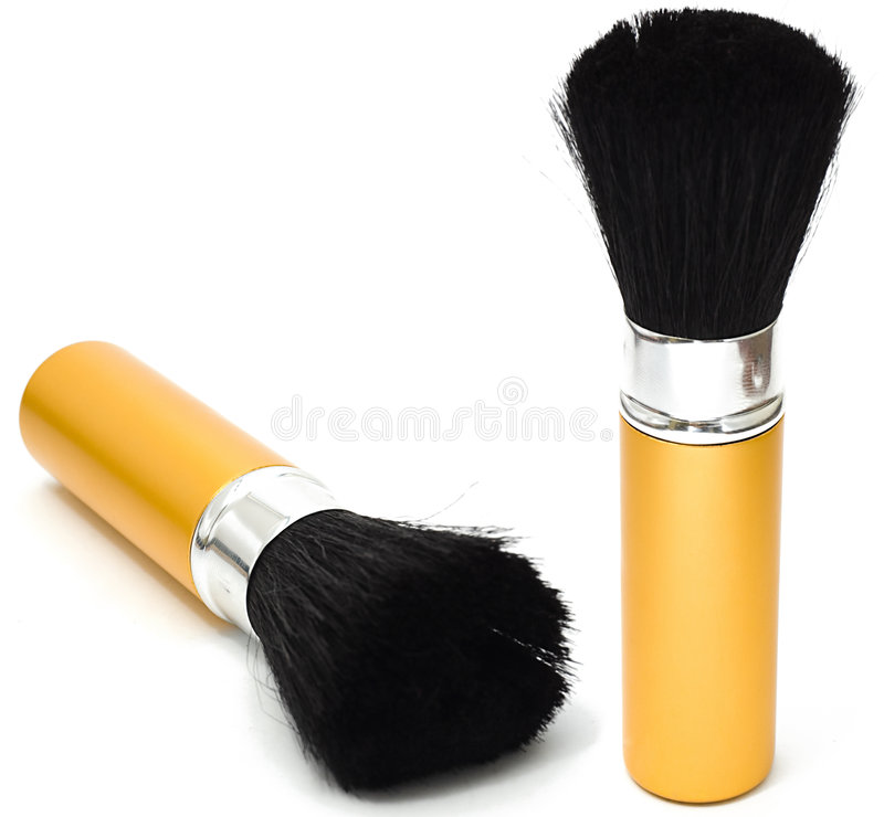 De borstel van de make-up van gouden kleur royalty-vrije stock foto's