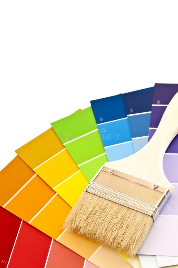 De borstel van de verf met kleurenkaarten stock fotografie
