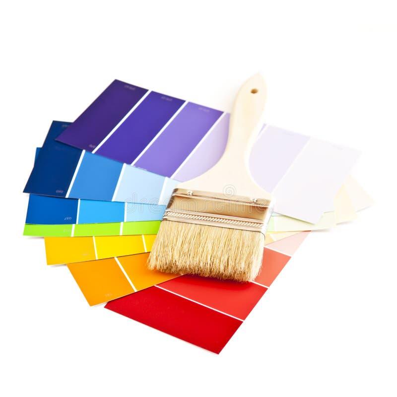De borstel van de verf met kleurenkaarten stock foto