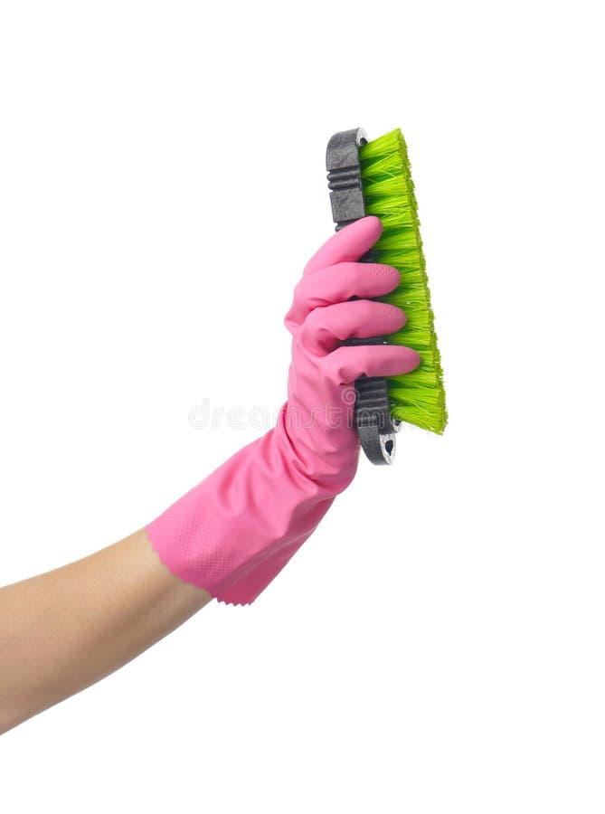 De borstel van de vrouwenholding voor het schoonmaken op witte achtergrond stock foto's