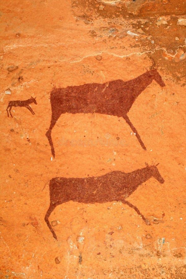 De Bosjesmannen schommelen het schilderen stock fotografie