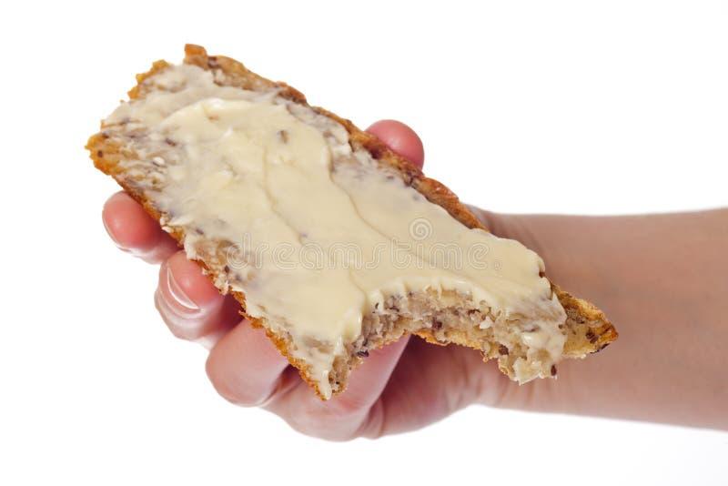 De boterham houdt ter beschikking een pindakaas royalty-vrije stock afbeelding