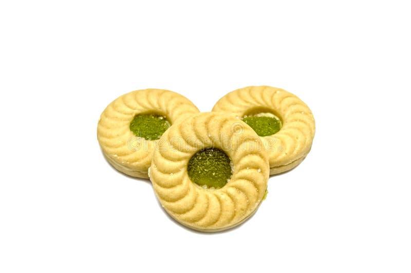 De boterkoekjes van de koekjessandwich met room en Kiwi en Apple op smaak gebrachte jam stock afbeeldingen