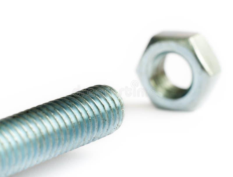 De bout en de noot van het roestvrij staal. stock foto