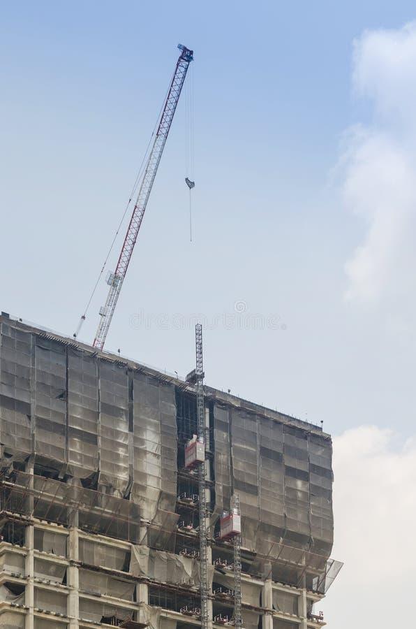 De bouw en kraan in aanbouw royalty-vrije stock foto's