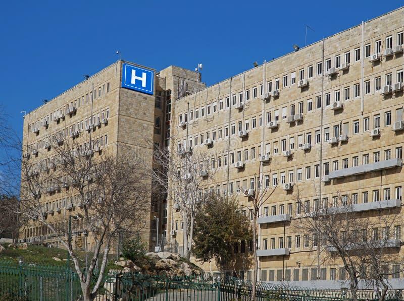 De bouw met blauw h-teken voor het ziekenhuis royalty-vrije stock foto