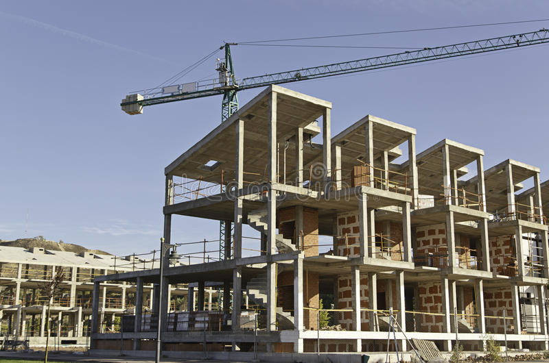 De bouw van de huisvesting royalty-vrije stock afbeeldingen