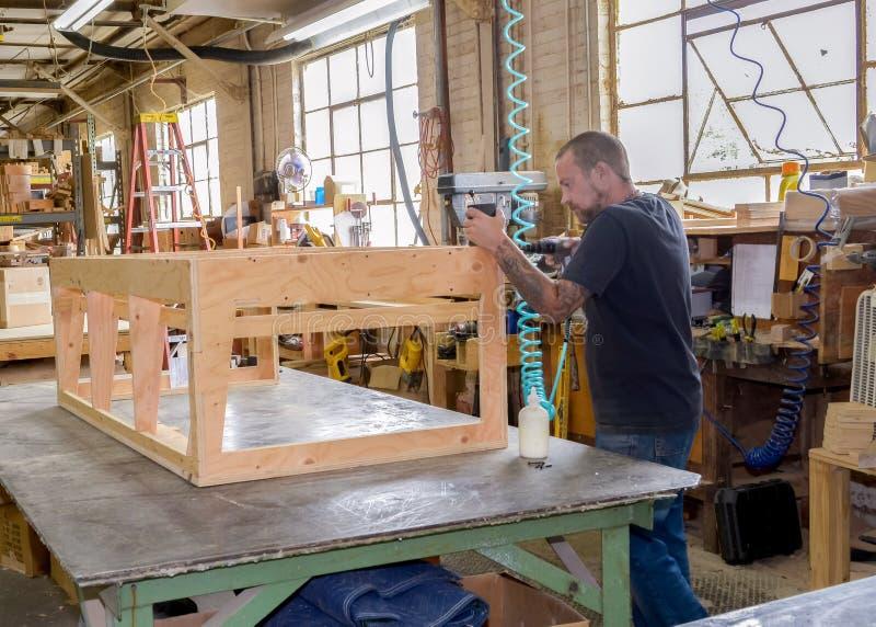 De bouwer van het meubilairkader; stock afbeeldingen