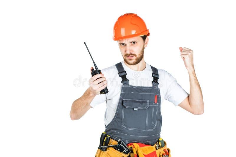 De bouwersbesprekingen, zweert op thewalkie-talkie Geïsoleerd op wit royalty-vrije stock afbeelding