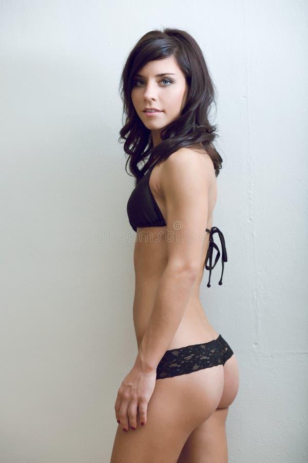 De bovenkant en de kousen van de bikini stock fotografie