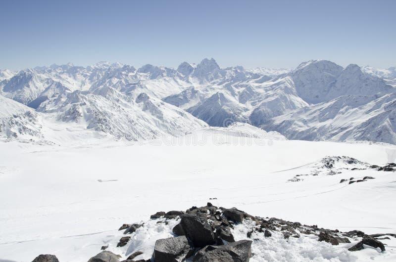 De bovenkant van Elbrus-bergen stock fotografie