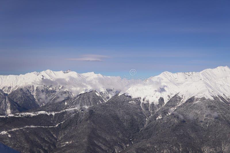 De bovenkant van de toevlucht van de de winterski van de Onderstelsneeuw stock afbeeldingen