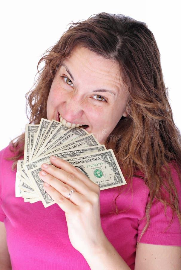 De boze vrouw eet geld stock fotografie