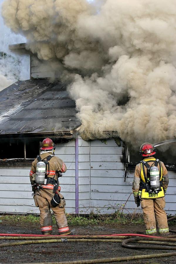 De brandbestrijders structureren Brand royalty-vrije stock foto