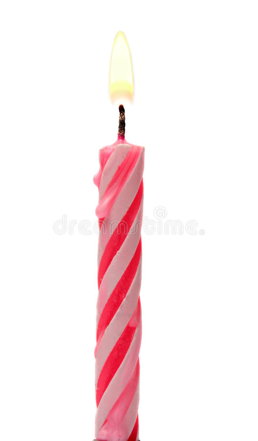 De brandende die Cake van de Verjaardagskaars op een Wit wordt geïsoleerd stock foto