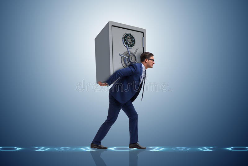 De brandkast van het zakenman stealing metaal van bank stock afbeeldingen