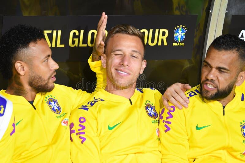 De brasilianska fotbollsspelarna Neymar Jr, Arthur och Dani Alves royaltyfria foton