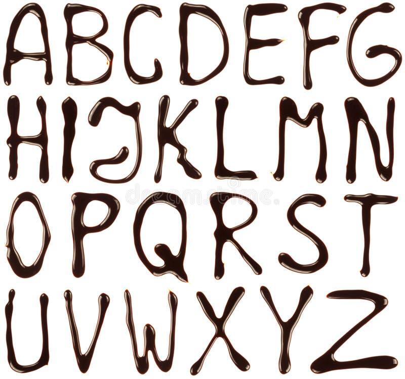 De brieven van het alfabet die met chocoladestroop worden geschreven royalty-vrije stock afbeeldingen