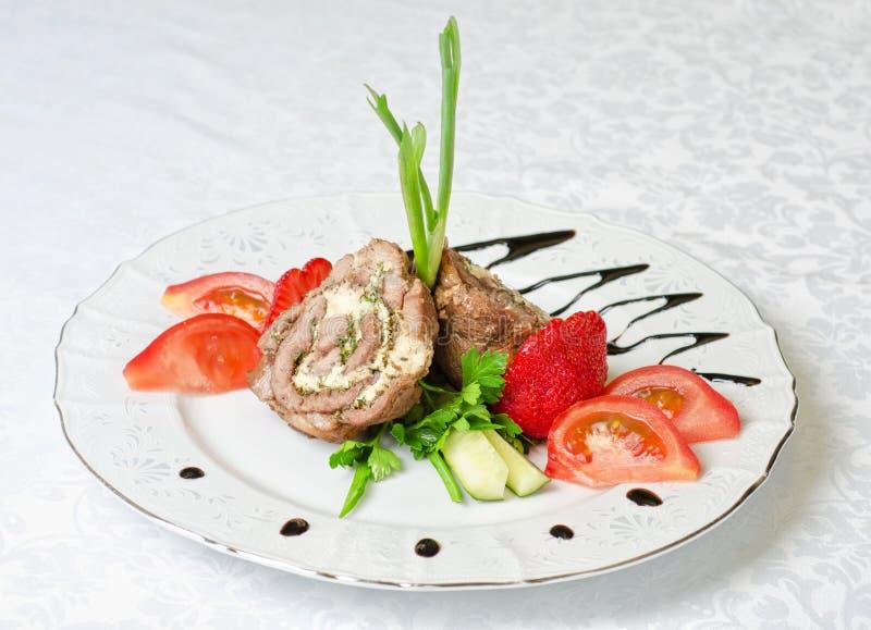 De broodjes van het varkensvlees met groenten stock foto's