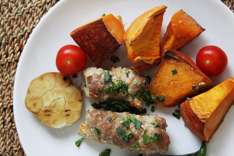 De broodjes van het varkensvlees met groenten royalty-vrije stock foto