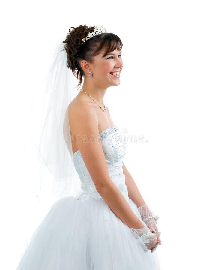De bruid kleedde zich in huwelijkskleding royalty-vrije stock afbeelding