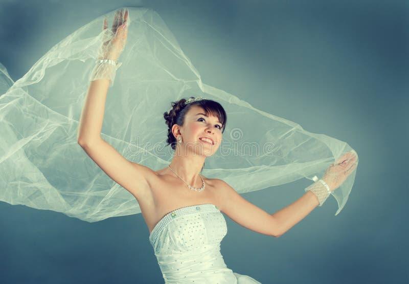 de bruid kleedde zich in kleding van het elegantie de witte huwelijk royalty-vrije stock afbeeldingen